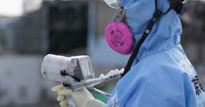 An employee uses a a radiation dosage monitor as workers continue the decontamination and reconstruction process. (Photo: Christopher Furlong/Getty)