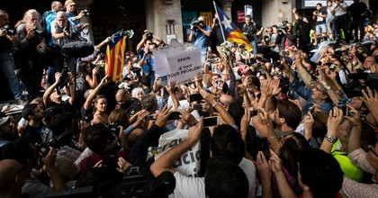 People holds up a ballot box which says 'Spain, is this your problem?' outside the Catalan Vice-President and Economy office as police officers holds a searching operation inside on September 20, 2017 in Barcelona, Spain. Spanish Civil Guard police have stormed several Catalan government ministries in an attempt to stop the region's independence referendum on October 1, which has been deemed illegal by the Spanish government in Madrid. (Photo: David Ramos/Getty Images)