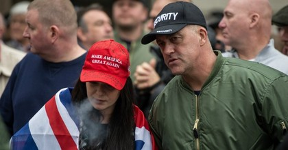 A woman wears a Donald Trump campaign hat that she has altered while speaking to a member of the Britain First security team during a protest titled 'London march against terrorism' organized by far-right groups English Defence League and Britain First. (Photo: Chris J Ratcliffe/Getty Images)