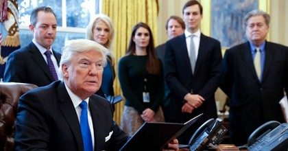 President Donald Trump in January 2017 surrounded by members of his senior staff, including White House chief of staff Reince Priebus, counselor to the President Kellyanne Conway, and Senior Counselor Stephen Bannon. (Photo: Shawn Thew-Pool/Getty Images)