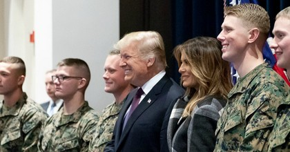 President Donald J. Trump alongside First Lady Melania Trump and members of the U.S. military in this file image posted to a government website to commemorate Veterans Day. (Photo: WhiteHouse.gov)