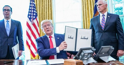 President Donald Trump signs with Vice President Mike Pence and Secretary of Treasury Steven Mnuchin at the White House on June 24, 2019. (Photo: Mandel Ngan/AFP/Getty Images)