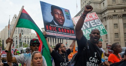On the five year anniversary of Eric Garner's death, and one day after federal prosecutors declined to bring charges against the arresting police officer Daniel Pantaleo, activists march around city hall to demand justice on July 17, 2019 in downtown New York City. On Monday, the NYPD announced that Pantaleo would be fired. (Photo: Andrew Lichtenstein/Corbis via Getty Images)