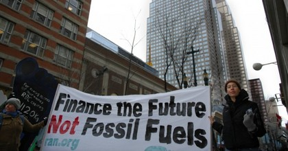 Sign reads: Finance the future not fossil fuels