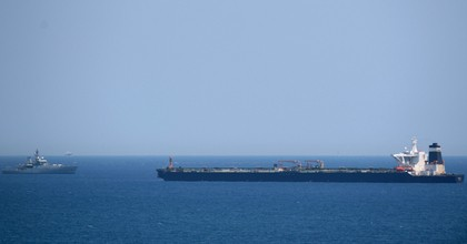 A British Royal Navy ship (L) patrols near supertanker Grace 1 suspected of carrying crude oil to Syria in violation of EU sanctions after it was detained off the coast of Gibraltar on July 4, 2019. (Photo: Jorge Guerrero/AFP/Getty Images)