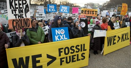 Opponents of the Keystone XL and Dakota Access pipelines protest President Donald Trump's executive orders advancing their construction, at Lafayette Park next to the White House