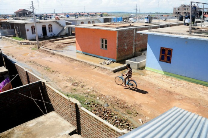 These half-built houses, part of a rehabilitation village in Kalmunai, were built using private funds. (Photo: Amantha Perera/IPS)