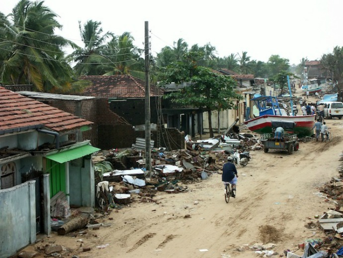 The village of Sainathimaruthu in eastern Sri Lanka was completely destroyed by the tsunami. Fisher families living along the coast faced another hurdle when the then Sri Lankan government initiated an ill-advised move to erect a 100-metre no-build buffer zone along the coast. The plan was later scrapped. (Photo: Amantha Perera/IPS)