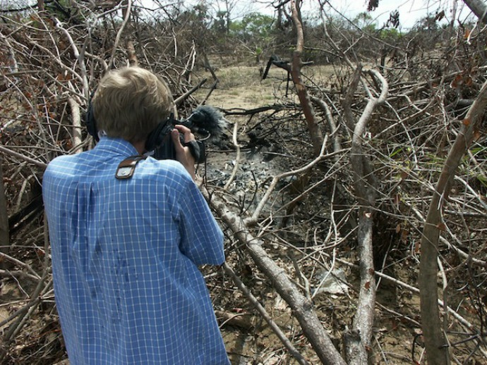 A photographer captures the burnt remains of a tsunami victim on the beach in the village of Pannichhankerni in the eastern Batticaloa District. Located within areas that were then controlled by the separatist Tamil Tigers, victims here found relief supplies slow to arrive, and then fell prey to squabbling between the Tigers and the government over aid distribution. (Photo: Amantha Perera/IPS)