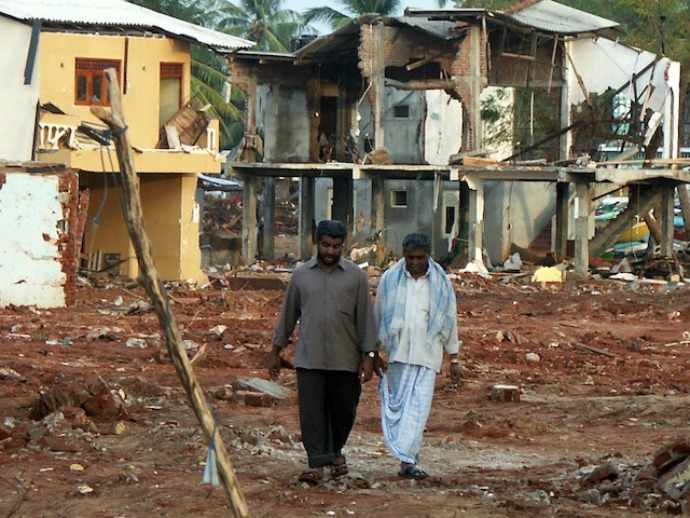 Men walk past destroyed buildings in the Hambantota town in southern Sri Lanka. Reconstruction in this town subsequently moved at a rapid pace. (Photo: Amantha Perera/IPS)