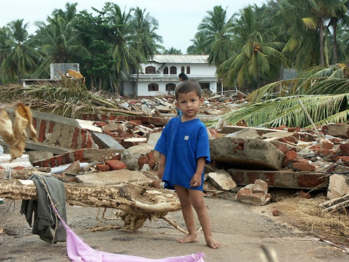 A small child stands amidst the destruction in the town of Hambantota, located in southern Sri Lanka. (Photo: Amantha Perera/IPS)