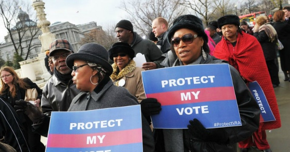 Activists hold a pro-voting rights placards outside of the U.S. Supreme Court on in Washington, D.C. (Photo: Mandel Ngan/Getty Images)
