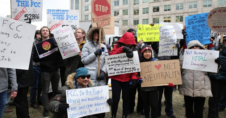 FCC commissioners Jessica Rosenworcel and Mignon Clyburn joined protesters outside the panel's headquarters on Thursday before issuing a dissent to Republican chair Ajit Pai's proposal to end net neutrality protections. The repeal was passed with a 3-2 vote. (Photo: Free Press/Flickr/cc)