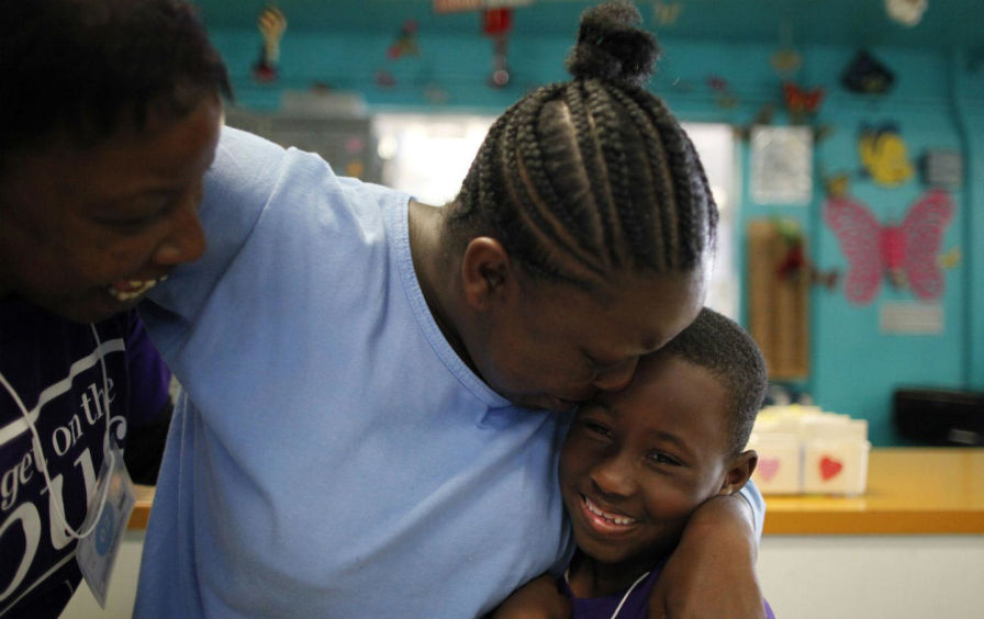 Shonta Montgomery hugs her son Levell Jones at California Institute for Women in Chino, California. (Reuters / Lucy Nicholson)