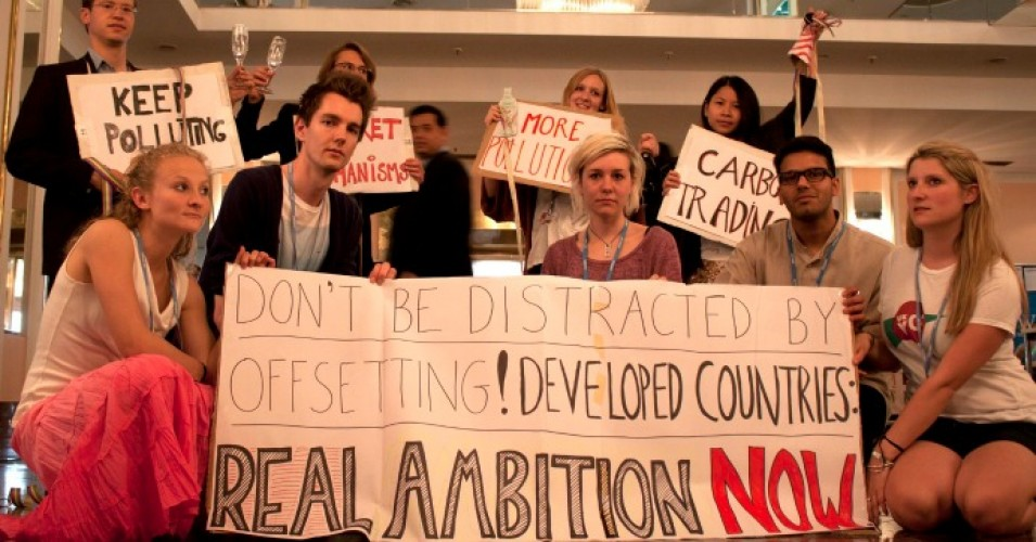 Young climate activists protest carbon markets at the UNFCCC negotiations in Bonn in 2012. (Photo: Young FoEE/flickr/cc)
