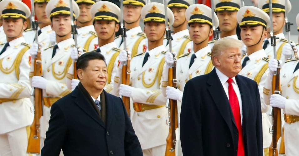 U.S. President Donald Trump takes part in a welcoming ceremony with China's President Xi Jinping on November 9, 2017 in Beijing, China. (Photo: Thomas Peter-Pool/Getty Images)