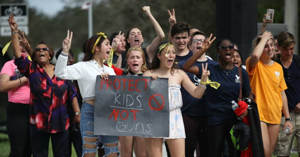Some of the hundreds of West Boca High School students arrive at Marjory Stoneman Douglas High School on Feb. 20, 2018 after they walked there in honor of the 17 people killed  in Parkland, Florida. (Photo: Joe Raedle/Getty Images)