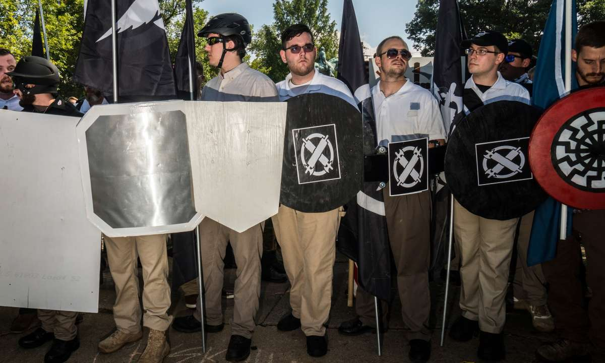 James Fields, in the centre with the circular shield. He wears the white polo shirt and khaki pants that are the group's uniform. Photograph: Go Nakamura/New York Daily News