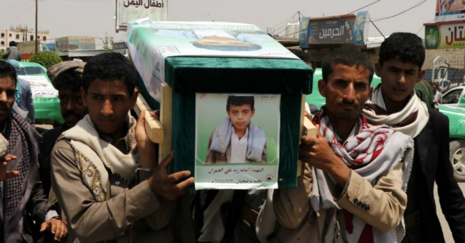 Mourners carry the coffin of a child at the funeral procession for those killed in an airstrike on a bus carried out last week by a warplane of the Saudi Arabia-led coalition on August 13, 2018 in Saada, Yemen. (Photo: Mohammed Hamoud/Getty Images)