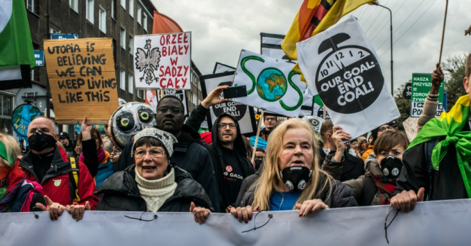 Environmental protesters take part in a Greenpeace-organized march to call for the political and economic reforms needed to combat climate change while the COP24 summit takes place in Katowice, Poland. (Photo: Martyn Aim/Getty Images)