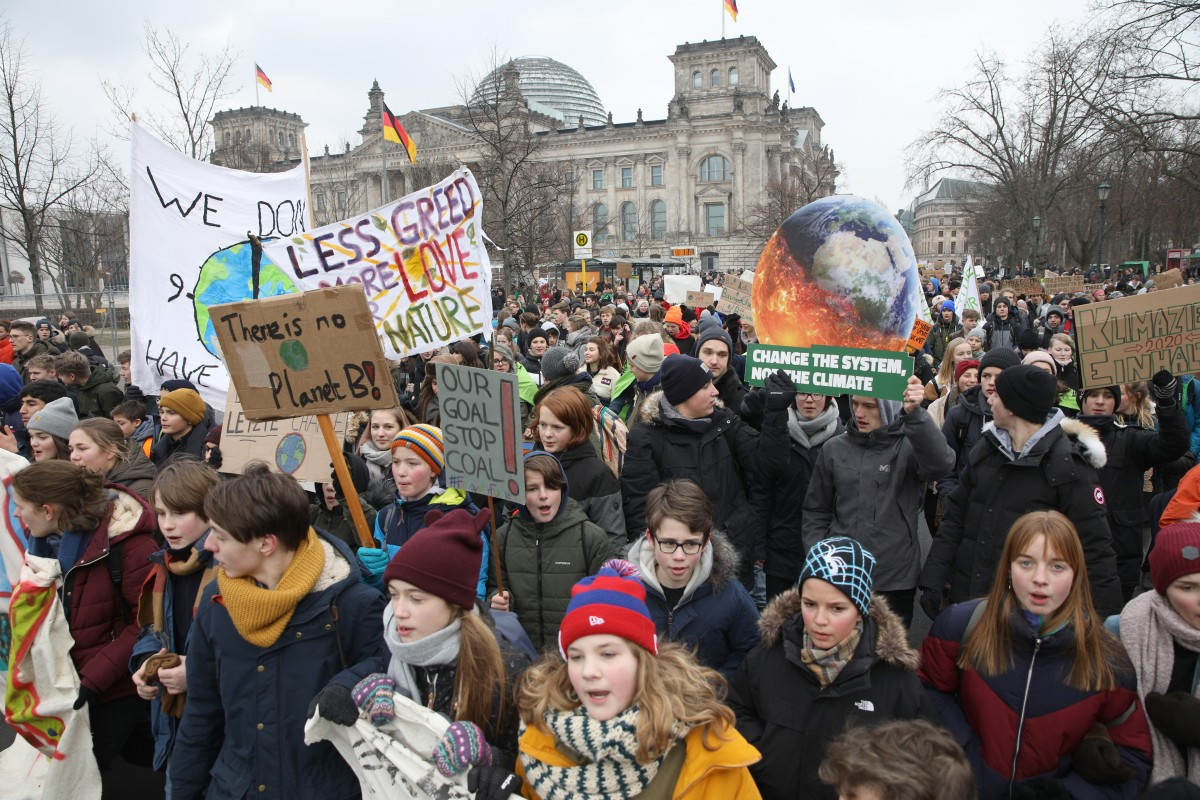 n front of the Ministry for the Economy, calling for an immediate end to coal produStriking high school students march in front of the Reichstag building, seat of the German Parliament the Bundestag, during a protest for more effective government climate change policy on January 25, 2019 in Berlin, Germany. (Photo by Omer Messinger/Getty Images)