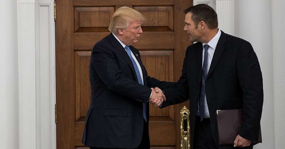 President Donald Trump and Kris Kobach, Kansas secretary of state, shake hands following their meeting with president-elect at Trump International Golf Club, November 20, 2016 in Bedminster Township, New Jersey. (Photo: Drew Angerer/Getty Images)
