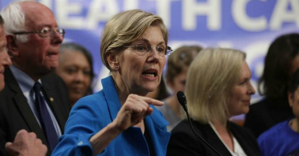U.S. Sen. Elizabeth Warren (D-Mass.) speaks on health care as Sen. Bernie Sanders (I-Vt.) listens during an event September 13, 2017 on Capitol Hill in Washington, D.C. (Photo by Alex Wong/Getty Images)