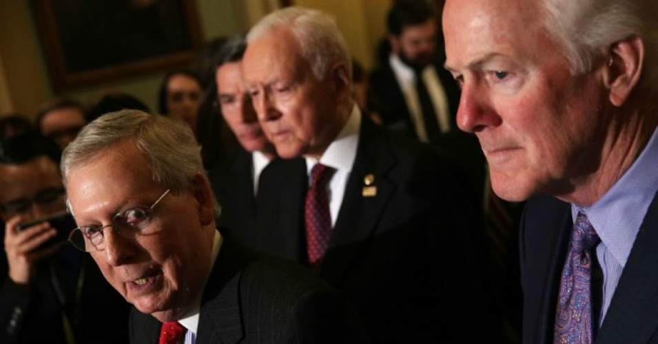 Senate Majority Leader Sen. Mitch McConnell (R-Ky.) speaks as Senate Majority Whip Sen. John Cornyn (R-Texas) and Sen. Orrin Hatch (R-Utah) listen during a news briefing after a weekly Senate Republican Policy Luncheon at the Capitol November 28, 2017 in Washington, D.C. (Photo: Alex Wong/Getty Images)