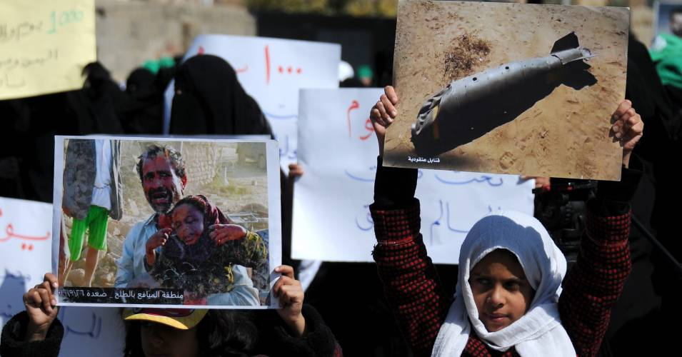 Yemeni children hold pictures of victims of airstrikes as they take part in a rally staged against the ongoing 1000-day war on Yemen by the U.S.-backed, Saudi-led coalition outside the United Nations Office on December 21, 2017 in Sana'a, Yemen. (Photo: Mohammed Hamoud/Getty Images)