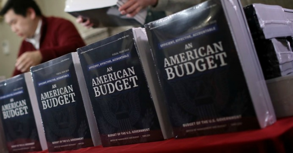 Staff members display recently released printed copies of U.S. President Donald Trump's fiscal year 2019 budget at the House Budget Committee on Capitol Hill February 12, 2018 in Washington, D.C. (Photo by Win McNamee/Getty Images)