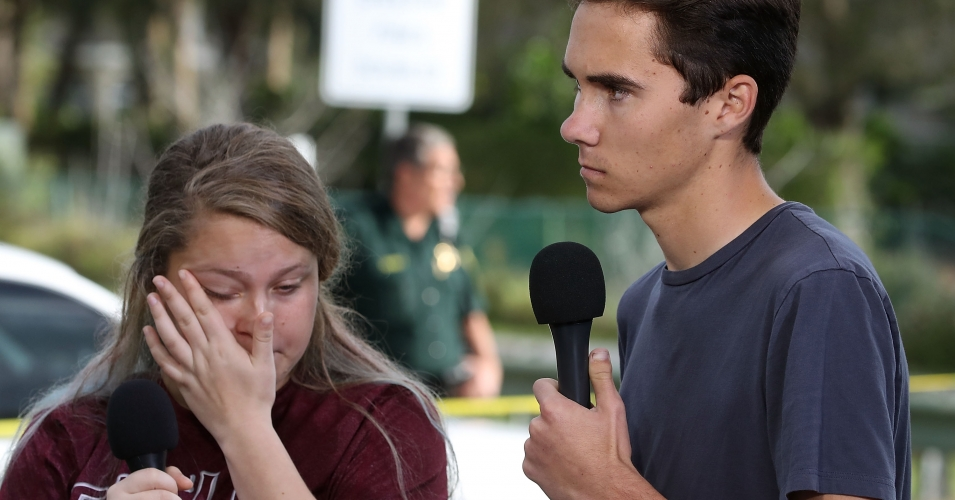 Students Kelsey Friend (L) and David Hogg recount their stories about yesterday's mass shooting at the Marjory Stoneman Douglas High School where 17 people were killed, on February 15, 2018 in Parkland, Florida. Police arrested the suspect after a short manhunt, and have identified him as 19 year old former student Nikolas Cruz. (Photo: Mark Wilson/Getty Images)