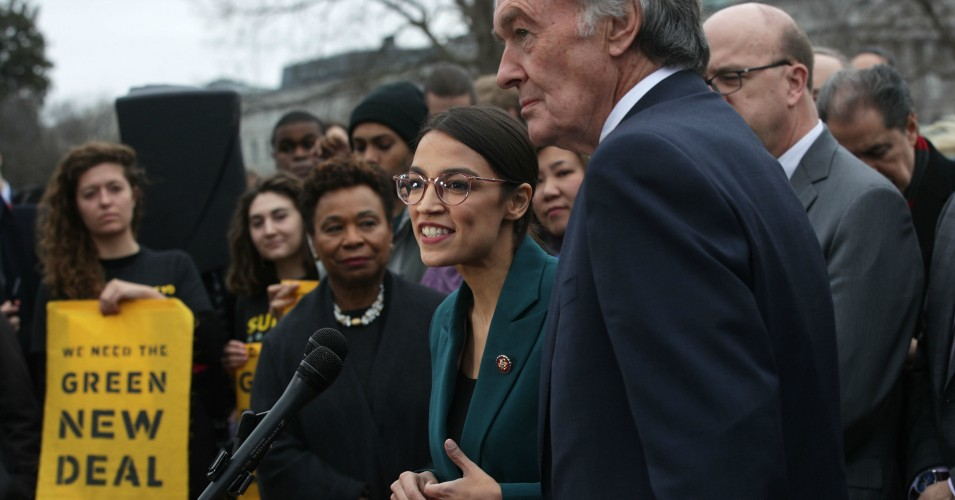 Rep. Alexandria Ocasio-Cortez (D-N.Y.) speaks as Sen. Ed Markey (D-Mass.) and other congressional Democrats listen during a news conference in front of the U.S. Capitol February 7, 2019 in Washington, D.C. (Photo: Alex Wong/Getty Images)