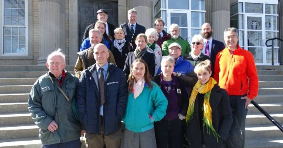 Defendants and legal team pose for a photo after their March 27, 2018  trail on the steps of the West Roxbury, Mass. courthouse. (Photo: Peter Bowden/flickr/cc)