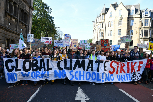 campaigners protest during a climate change action day on September 20, 2019 in Edinburgh, Scotland. Protests are taking place today worldwide, with campaigners demanding that governments and corporations take steps towards lowering CO2 emissions and combating the warming of the Earth's temperatures. (Photo by Jeff J Mitchell/Getty Images)