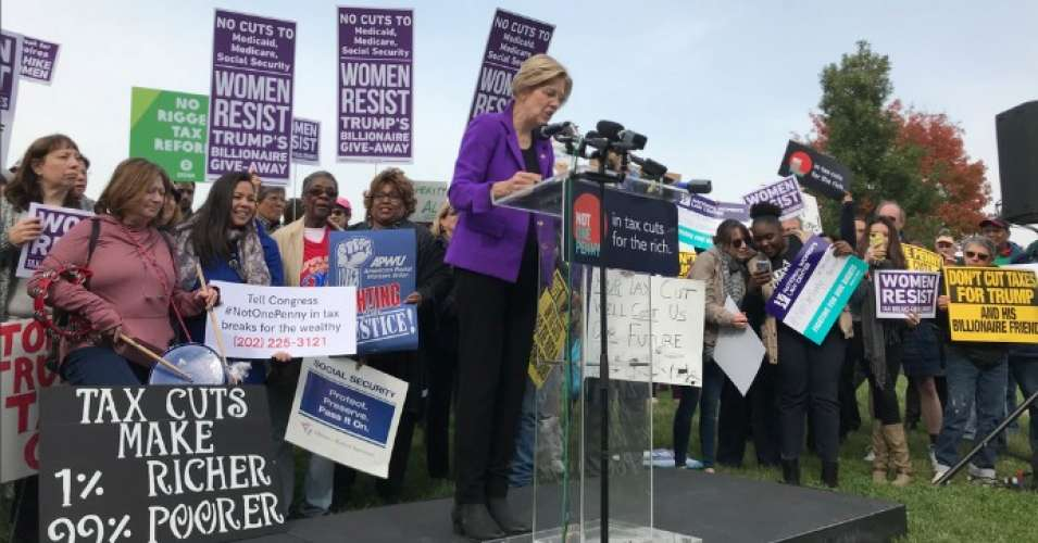 "Sen. Elizabeth Warren (D-Mass.) speaking at Wednesday's rally.""The reality is that this will be a tax bill that transfers 80 percent of the tax cuts to the wealthiest one percent,"" warned Rep. Pramila Jayapal in her comments. (Photo: Public Citizen/Twitter)"
