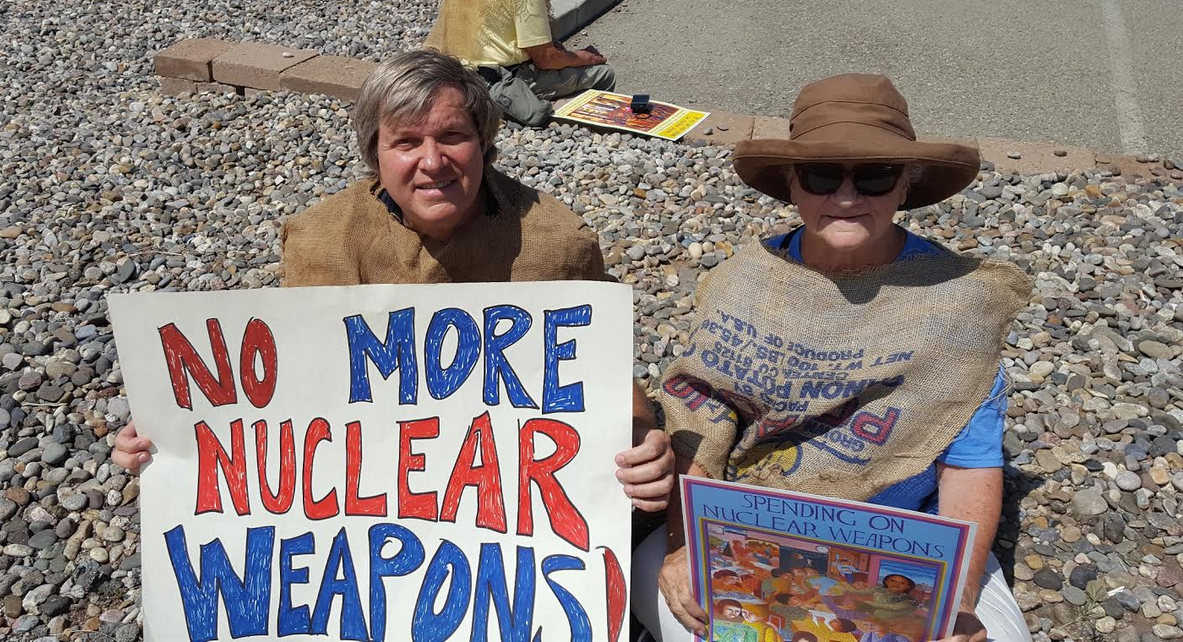 The author (l) sits with another activist during the nonviolent demonstration in Los Alamos, New Mexico over the weekend. (Photo: Courtesy of the author)