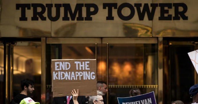 Activists rally and call on the Trump administration to meet tomorrow's court ordered deadline to return immigrant children to their families after being separated at the southern border, outside Trump Tower in Midtown Manhattan, July 25, 2018. (Photo: Drew Angerer/Getty Images)