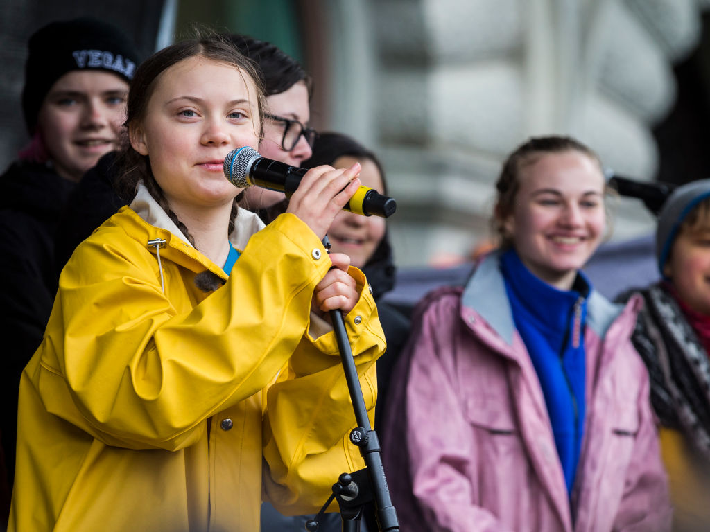 Greta Thunberg participates in a strike outside of the Swedish parliament house, Riksdagen, in order to raise awareness for global climate change on March 15, 2019 in Stockholm, Sweden. (Photo by MICHAEL CAMPANELLA/Getty Images)