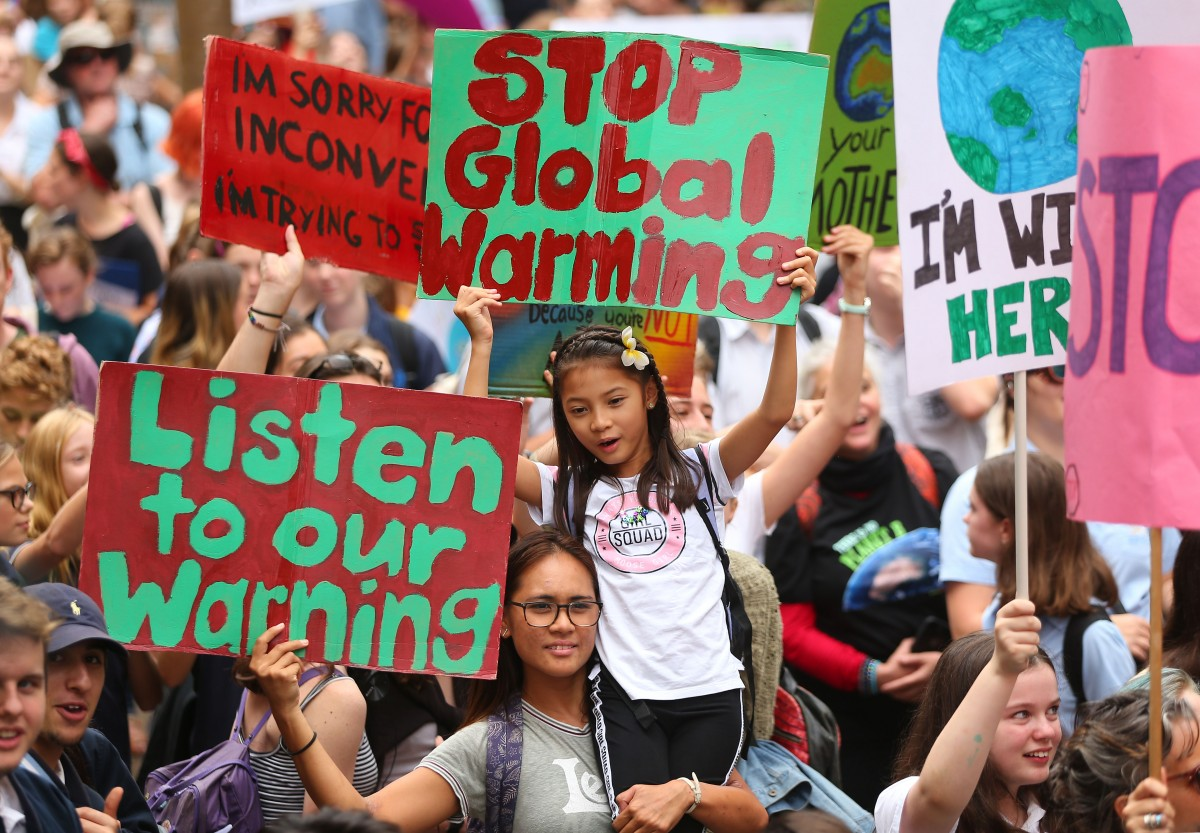 People hold up signs and vent their frustrations during a Climate Change Awareness rally at Sydney Town Hall on March 15, 2019 in Sydney, Australia. The protests are part of a global climate strike, urging politicians to take urgent action on climate change. (Photo by Don Arnold/Getty Images)