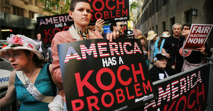 Activists hold a protest near the Manhattan apartment of billionaire and Republican financier David Koch in New York City. (Photo: Spencer Platt/Getty Images)