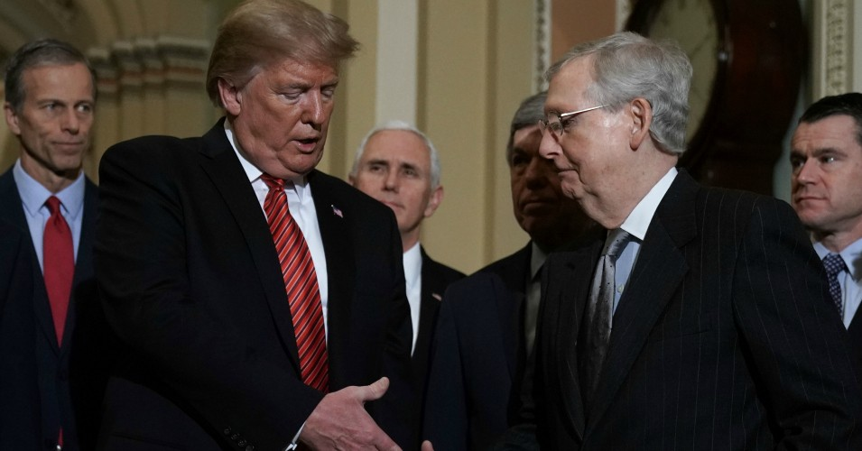 President Donald Trump shakes hands with Senate Majority Leader Sen. Mitch McConnell (R-Ky.) at the U.S. Capitol in Washington, D.C. (Photo: Alex Wong/Getty Images)