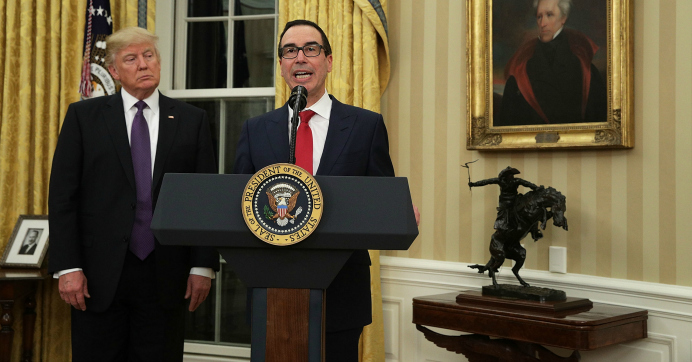 Treasury Secretary Steve Mnuchin speaks as US President Donald Trump looks on during a swearing-in ceremony in the Oval Office in Washington, D.C. (Photo: Alex Wong/Getty Images)