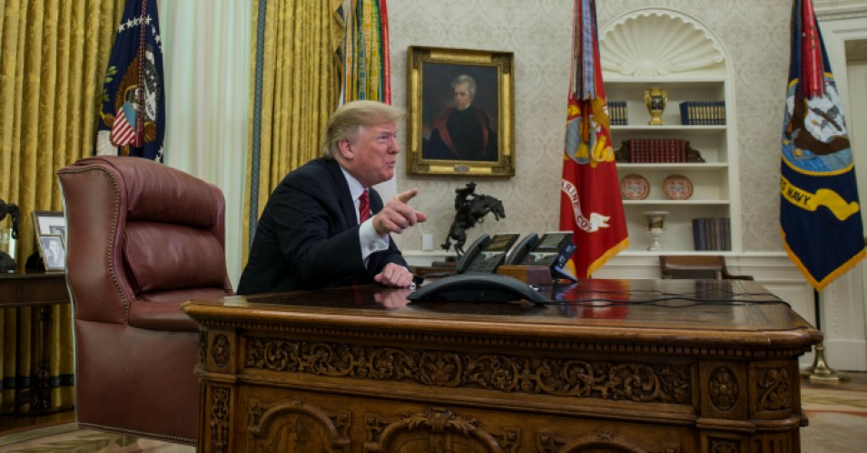 President Donald Trump makes a video call to service members from the Army, Marine Corps, Navy, Air Force, and Coast Guard stationed worldwide in the Oval Office at the White House December 25, 2018 in Washington, DC. (Photo: Zach Gibson-Pool/Getty Images)