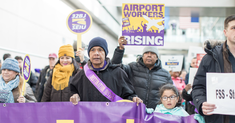 Airport workers hold signs and march during a rally for employees affected by the government shutdown at Boston Logan International Airport on January 21, 2019 in Boston, Massachusetts. (Photo: Scott Eisen/Getty Images)