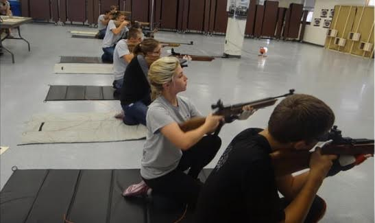 JROTC students at Marjory Stoneman Douglas High school practice firing air rifles in the school's cafeteria. The military classifies these guns as lethal weapons. This image has been removed from the high school's website.