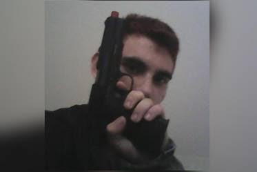 "Nikolas Cruz with his M1911 look-alike ""airsoft"" pistol."