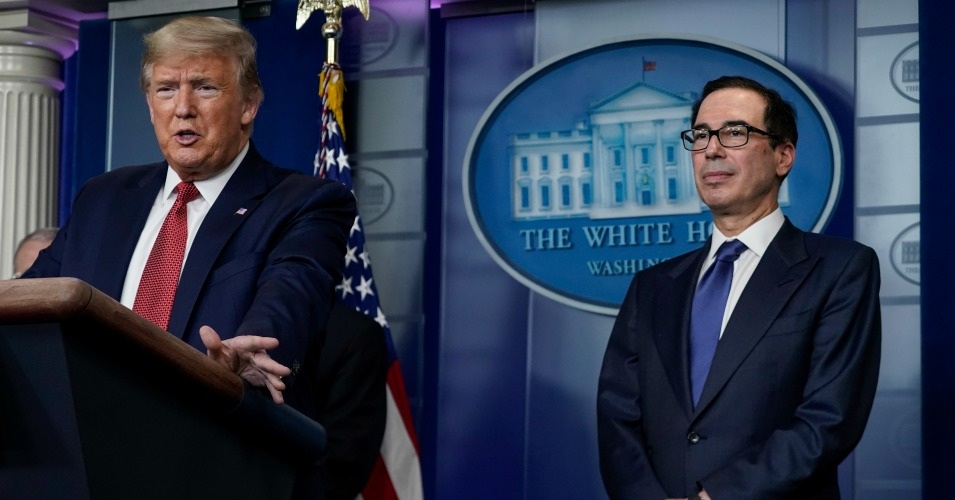 U.S. President Donald Trump, joined by Secretary of the Treasury Steven Mnuchin, speaks during a briefing on the coronavirus pandemic, in the press briefing room of the White House on March 25, 2020 in Washington, DC. (Photo: Drew Angerer/Getty Images)