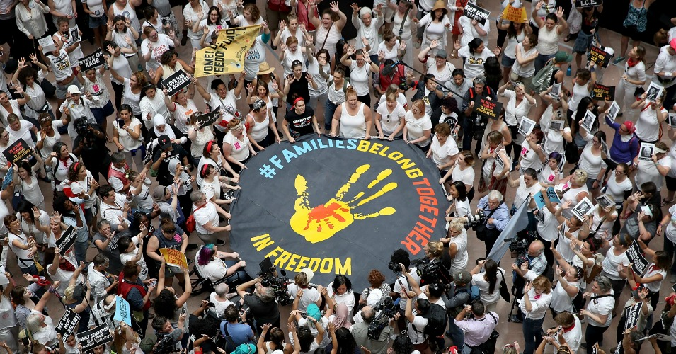 Protesters who marched from Freedom Plaza to the U.S. Capitol demonstrate inside the Hart Senate Office Building against family detentions and to demand the end of criminalizing efforts of asylum seekers and immigrants on June 28, 2018 in Washington, D.C. (Photo: Win McNamee/Getty Images)