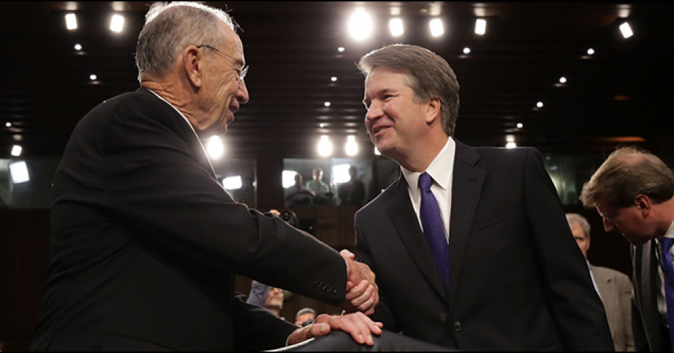 Sen. Chuck Grassley, Republican chair of the Senate Judiciary Committee, shakes hands with Brett Kavanaugh, President Donald Trump's far-right nominee to the U.S. Supreme Court. (Photo: Getty)