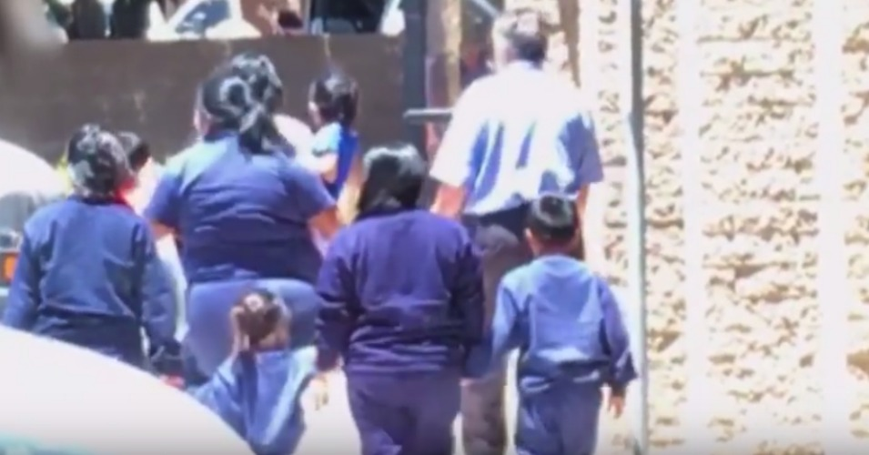 A neighbor filmed children being taken into a vacant office building in Phoenix, Arizona, and showed the footage to reporters when she suspected the children were immigrants who had been detained and possibly separated from their parents. (Photo: Reveal/YouTube)